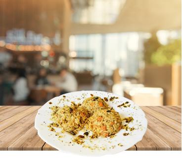 Dušen riž z bučnim oljem in semeni